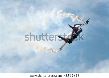 RUSSIA, MAKS - AUGUST 28: MIG-29 OVT fighter performing aerobatic elements and ejecting thermal traps (salute) at MAKS  aviation salon August 28, 2007 in Zhukovski, Russia