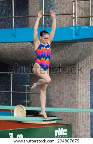 RUSSIA, MOSCOW - APRIL 29 2015: Athlete G. Sitnikova jumps from diving-tower in Pool on Moscow city diving tournament in Moscow, Russia, 2015