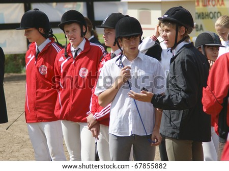 """RUSSIA, MOSCOW - AUG 8: Sportsmen compete in equestrian sport """"Youthful competitions on concur"""" August 8, 2009 in Moscow, Russia - stock photo"""