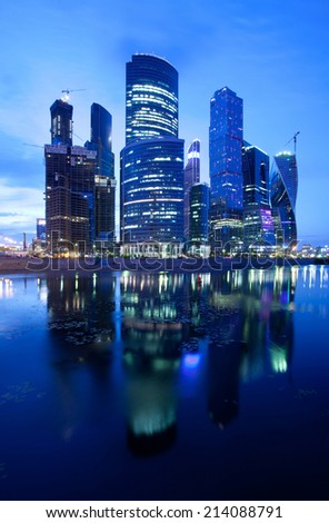Russia, 30.06.2014, Moscow City skyscrapers at night reflected in the river.  - stock photo