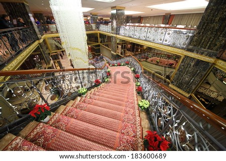 RUSSIA, MOSCOW - DEC 11, 2013: Staircase with ornate carpet in the hall of Lotte Plaza Hotel.