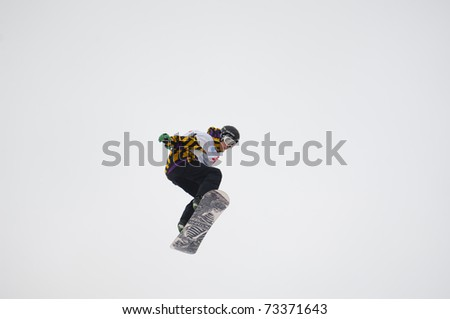 RUSSIA, MOSCOW - FEBRUARY 28: The unrecognized sportsman on Championship of Russia on a snowboard in disciplines half-pipe and big-air in New-Peredelkino, Moscow on February 28th, 2010 - stock photo