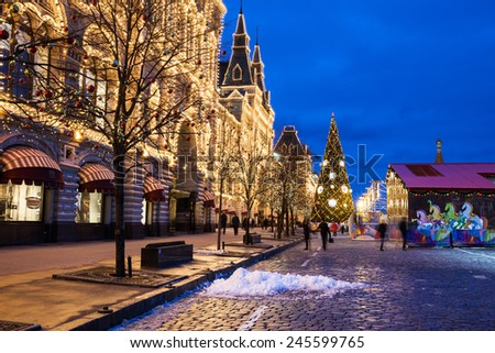 Russia, Moscow - 15 January, 2015: Illuminated GUM and Christmas market in holiday decoration on the Red Square on January 15, 2015, Moscow, Russia. - stock photo