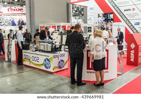 "RUSSIA, MOSCOW - June 14, 2016: Visitors and exhibitors visiting the stands and exhibits at the exhibition ""RosUpack"" at Crocus Expo. Exhibition held in Moscow. International Exhibition. - stock photo"