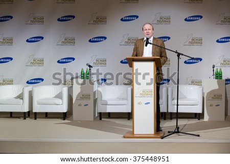RUSSIA, MOSCOW - 05 MAR, 2015: Director of museum Vladimir Tolstoy in suit is standing on stage at literary award Yasnaya polyana. - stock photo