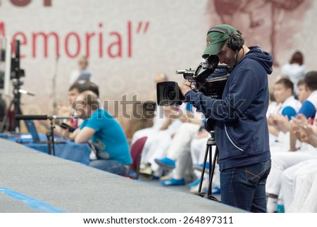 RUSSIA, MOSCOW - MARCH 27: Unidentified cameraman filming on World Sambo Championship Kharlampiev memorial in Luzhniki sport palace, Moscow, Russia, 2015