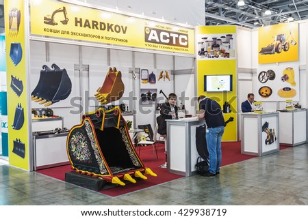 RUSSIA,MOSCOW - May 31,2016:exhibitors visiting the stands and exhibits at the International Specialized Exhibition of Construction Equipment and Technologies at Crocus Expo.Focus on bucket excavators - stock photo