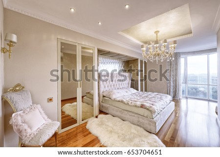 Russia, Moscow - modern designer renovation in a luxury building. Stylish bedroom interior with double bed.