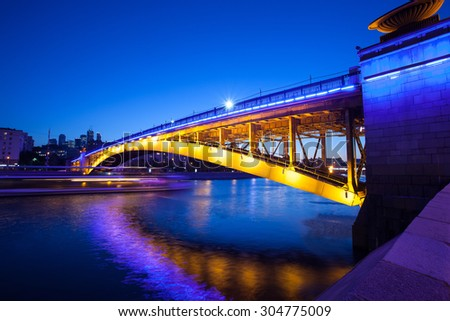 Russia, Moscow Night urban landscape with old Smolensky Metro Bridge. Blurred motion, long exposure - stock photo