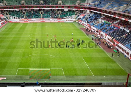 RUSSIA, MOSCOW - NOV 02, 2014: Football players are going on the field of Locomotive sports arena.