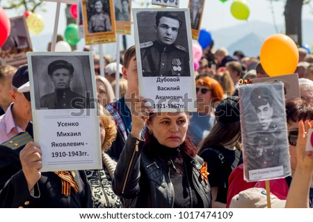 Russia, Nakhodka, 05/09/2017. Annual event Immortal Regiment on Victory Day (May 9). People hold portraits of relatives, soldiers of World War 2 and Great Patriotic War between USSR and Nazi Germany.