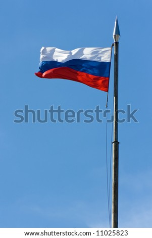 Russia national flag on the blue sky