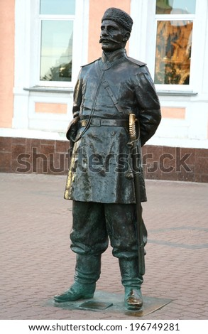 RUSSIA, NIZHNY NOVGOROD - JUNE 02, 2014: Sculpture Policeman of the 19th century at the main pedestrian historical street Bolshaya Pokrovskaya.