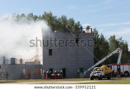 RUSSIA, NOGINSK - AUGUST 7, 2015: Indicative doctrines of rescuers of Emercom of Russia on rescue of victims after explosion in the industrial building;  - stock photo