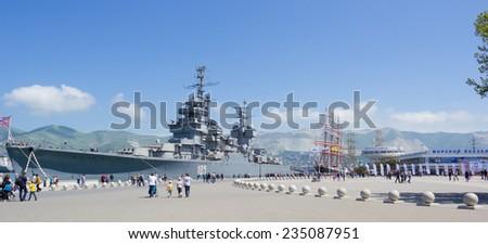 "RUSSIA, NOVOROSSIYSK - MAY 9, 2014:Artillery cruiser ""Mikhail Kutuzov"" in the port of Novorossiysk. Artillery cruiser Mikhail Kutuzov branch of the Museum of Black sea fleet in Novorossiysk - stock photo"