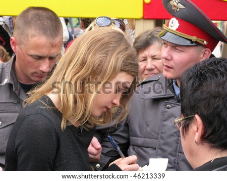 RUSSIA -OCTOBER 11: Natalia Vodianova at opening to children's playground, distributes autographs. October 11, 2009 in Biysk.