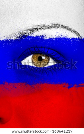 Russia or Russian flag painted over female face - stock photo