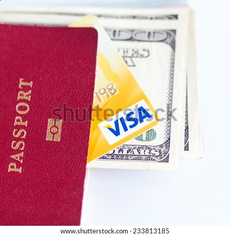 RUSSIA, OREL - 28 NOVEMBER 2014: International passport, dollar bills and credit card by Visa. White background - stock photo