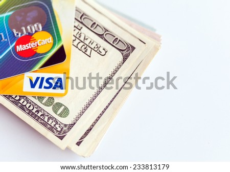 RUSSIA, OREL - 28 NOVEMBER 2014: Two credit cards by Mastercard and Visa and dollar bills