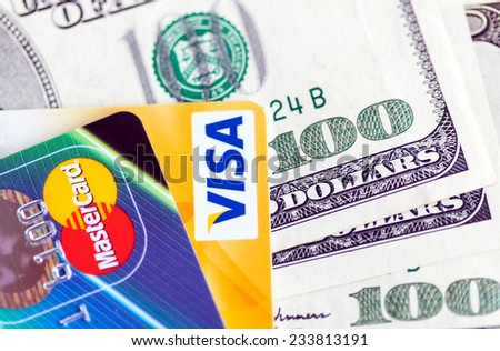 RUSSIA, OREL - 28 NOVEMBER 2014: Two credit cards by Mastercard and Visa and dollar bills - stock photo