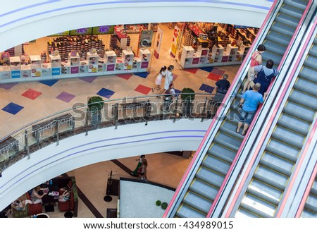 "RUSSIA, OREL, SHOPPING MALL ""GRIN"" - 26 JULY: View on the shoping mall and people on escalator"