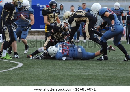 RUSSIA, PODOLSK CITY - JULY 27: V. Prosyan (33) fall down on friendship football game Spartans vs Vityazi on July 27, 2013, in Moscow region, Podolsk city, Russia