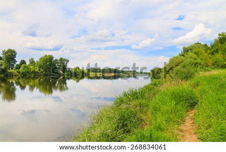 russia River Kliazma and its banks, Sky is cloudy. - stock photo