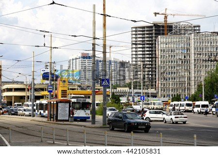 RUSSIA. ROSTOV on DON - JUNE 16, 2016:  Traffic moving on a background of construction of modern buildings in the Leninsky district of the city.