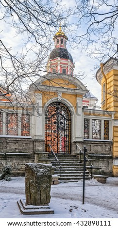 Russia. Saint Petersburg. Alexander Nevsky lavra at a frosty winter day. The gate of Nikolskoe Cemetery and the dome of the Blagovecshenskaya church. - stock photo