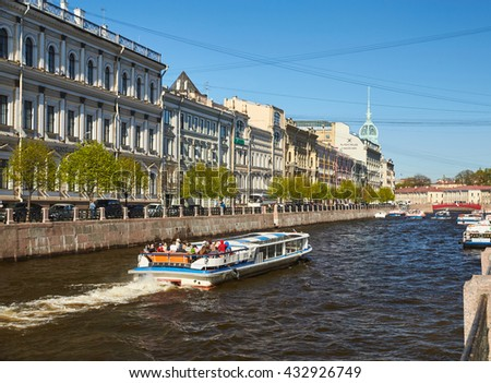 Russia, Saint-Petersburg, 08 May 2016: Moyka River Embankment panorama towards Red Bridge, shopping center, ships, boats, water navigation, tourists, the historical center, Herzen's university