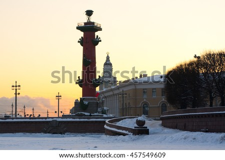 Russia. Saint Petersburg. Winter. Rostral column and curiosities at sunset