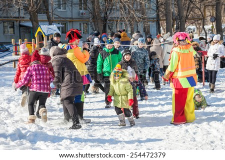 RUSSIA, SAMARA - FEBRUARY 20, 2015: Russian people celebrates Shrovetide. Maslenitsa or Pancake Week is the Slavic Holiday that dates back to the pagan times - stock photo