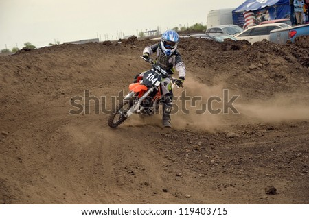 RUSSIA, SAMARA - MAY 6:  N. Kornev by motorcycle motocross performs the rotation on track  MX, the 65 sm3 class the Regional Motocross Championship on May 6, 2012 in Samara, Russia - stock photo