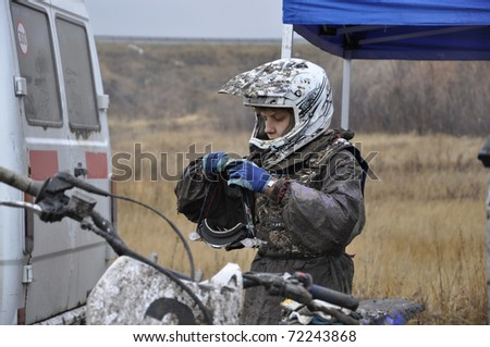 "RUSSIA, SAMARA - NOVEMBER 7: Russia, Samara, motocross ""End of Season"", November 7,2010, racer S.Nikishkin, dirty after finish"