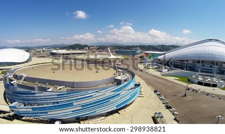 RUSSIA, SOCHI - JUL 26, 2014: Olympic complex with stadiums Bolshoy and Shaiba on sea shore at summer sunny day. Aerial view. Photo with noise from action camera. - stock photo