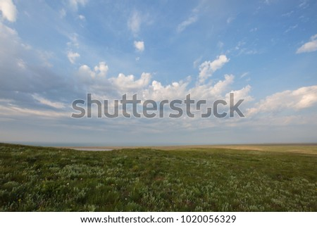 Russia. The movement of clouds in the spring in the steppe part of the Crimea peninsula at Cape Opuk.