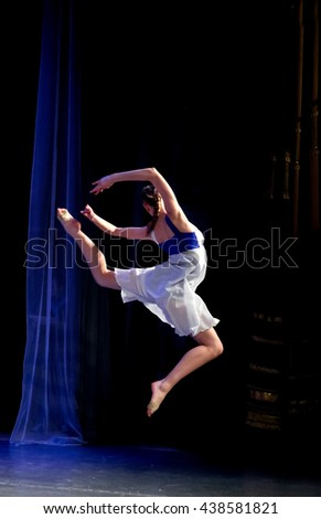 Russia, Tomsk, December 6, 2015 - Girl dancing modern dance. She hung in the air in a jump
