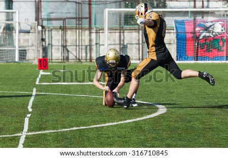 RUSSIA, TROITSK CITY - JULY 11: S. Kalashnikov (8) on free shot during Russian american football Championship game Spartans vs Raiders 52 on July 11, 2015, in Moscow region, Troitsk city, Russia