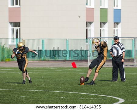 RUSSIA, TROITSK CITY - JULY 11: Sergey Kalashnikov (8) on free shot during Russian american football Championship game Spartans vs Raiders 52 on July 11, 2015, in Moscow region, Troitsk city, Russia - stock photo