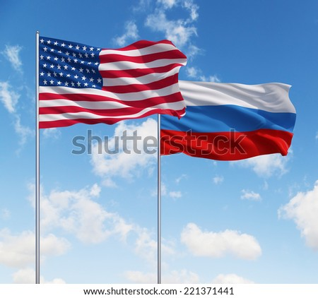 Russian and USA flags on a blue sky background. - stock photo