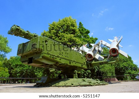 Russian anti-aircraft missile station gets ready in park. Shot in June, near Dnieper river (Dniepropetrovsk, Ukraine). - stock photo