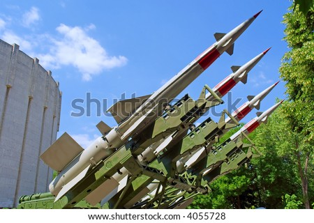 Russian anti-aircraft missiles  in front of building wall. Shot in June, near Dnieper river (Dniepropetrovsk, Ukraine). - stock photo
