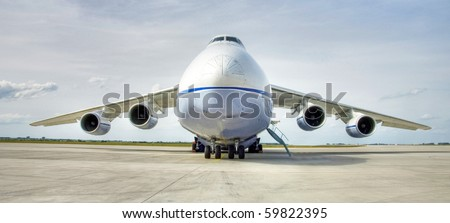 Russian antonow cargo airplane as a closeup wide angle shoot, hdr image with high dynamic range and compression - stock photo
