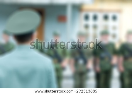 Russian army theme with armed soldiers blur background with bokeh - stock photo