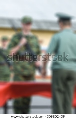 Russian army theme with armed soldiers blur background with bokeh