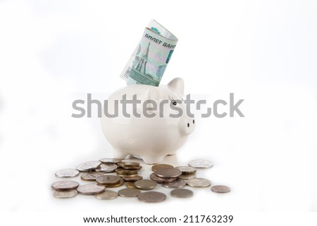 Russian banknotes and coins in the piggy bank on white background