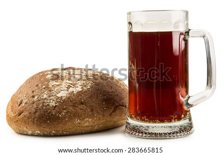 Russian brew in mug and loaf of wheat and rye flour isolated on white background