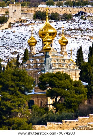 Russian church with with rare snow (Jerusalem, Mt. Olives) - stock photo