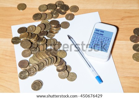 russian coins, pen, paper and a calculator on the table closeup - stock photo