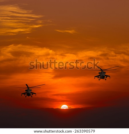 Russian Combat helicopters Mi-24, warm sunset, sunset on the beach - stock photo